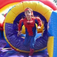Spider-Man has fun on one of the inflatables at the post-parade carnival at Beth Jacob on March 5.