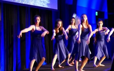 Members of the Weber School dance ensemble perform a special dance on the theme of the seven steps of mikvah preparation.