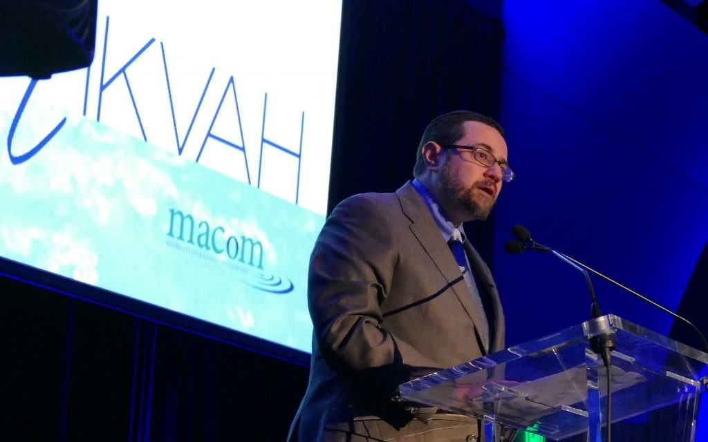 Rabbi Joshua Heller speaks during the Mitzvah for the Mikvah gala.