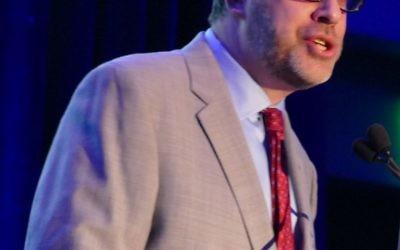 The Temple Rabbi Peter Berg introduces Rabbi Alvin Sugarman.