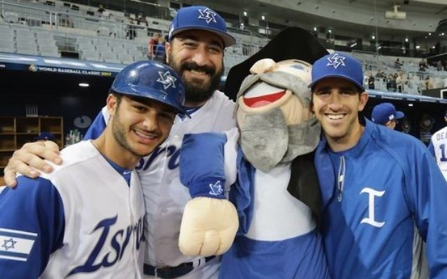 The Mensch on a Bench helps Team Israel celebrate its first-round success in the World Baseball Classic.