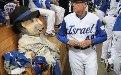 Manager Jerry Weinstein and Team Israel's mascot, the Mensch on a Bench