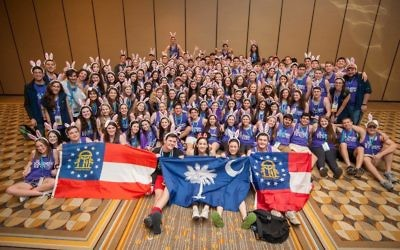 Members of Atlanta Council and other parts of BBYO's Southern Region sport bunny ears, representative of Southern Region mascot Bugs Bunny, during a group photo at the BBYO International Convention.