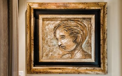 This portrait of David as a young boy, displayed in the TV room, is the first piece of art the couple collected together.