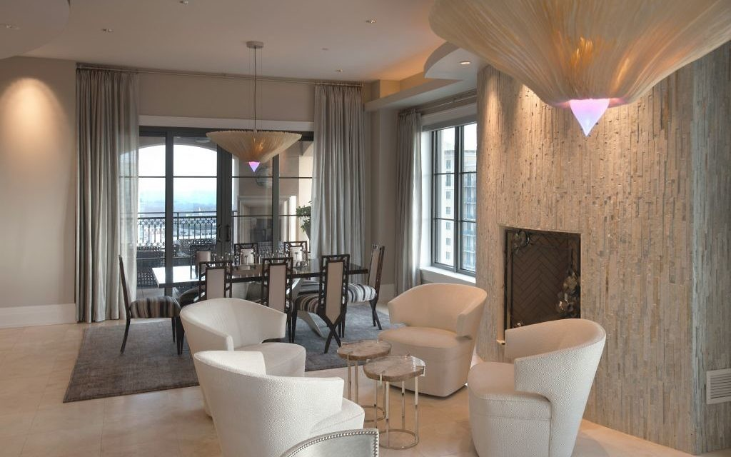 The expansive living/dining area is graced by recycled-paper chandeliers with unusual neon tips.