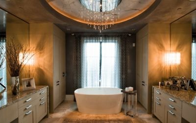 The master bathroom features a spectacular chandelier.