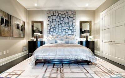 The Alpern master bedroom has a square leather headboard for a dramatic effect.