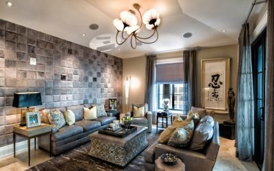 The TV room expands on the leather-themed walls with a sea-urchin chandelier. The family's cherished Meisner Torah from Tsfat is on an end table in the back-left corner.