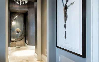 """The Craig Alan painting """"Cardinal Marks,"""" done in fewer than 10 strokes, joins the waterfall down the hall to make the master wing more exotic."""