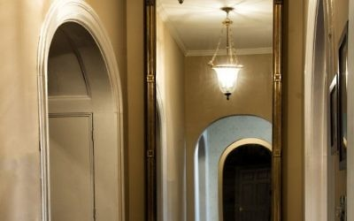 This original floor-to-ceiling hallway mirror was gilded in 1980 over the original mahogany.