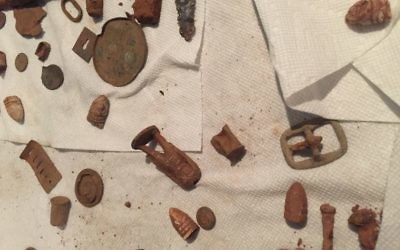A three-day search of the ground turned up relics such as a belt buckle, toy soldiers and bullets, some with bite marks.