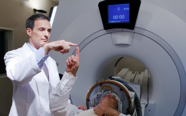 Photo courtesy of Israel21C An Israeli doctor uses an MRI-based system for nonsurgical cancer treatment.