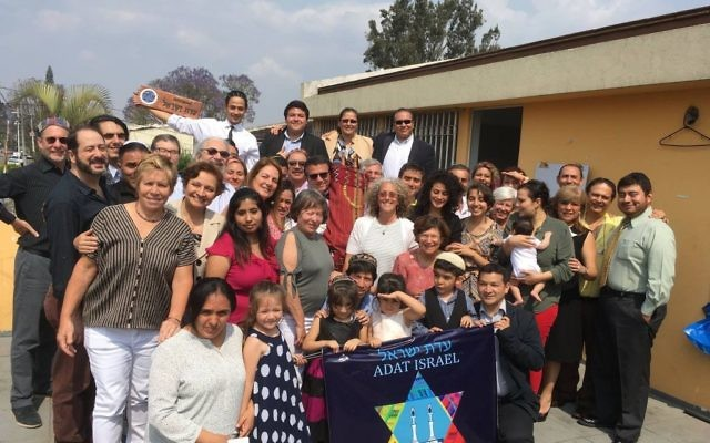 Adat Israel in Guatemala City welcomes its new Torah, a gift from the defunct Congregation Anshe Emeth in Arkansas.