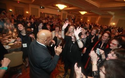"Rep. John Lewis and National Council of Jewish Women members dance to Pharrell Williams' ""Happy"" at the JW Marriott in Buckhead on March 25."