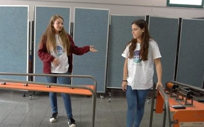 Students demonstrate a mobile physics exhibition at Mada-Na.