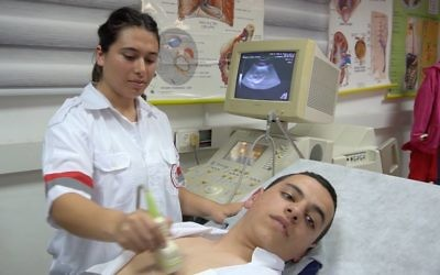 A Rabin High School student demonstrates an ultrasound machine in the World ORT school's medicine and science track.