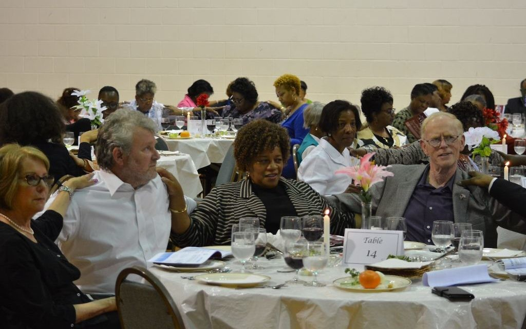 Members of Temple Emanu-El and Greater Piney Grove Baptist Church share a mid-Passover seder in the Old 4th Ward. (Photo by Merical Alexander)