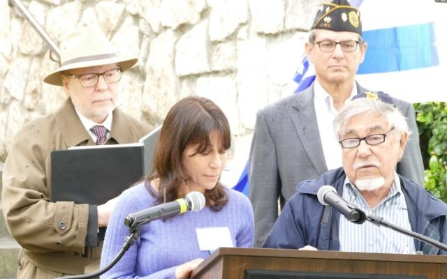 Ben Walker and daughter Ronit Walker present a Yiddish reading in front Harold Kirtz and Robert Max at the 2017 Yom HaShoah observance at the Memorial to the Six Million at Greenwood Cemetery.