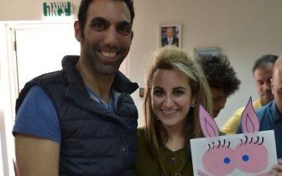 Israel ORT alumnus Matan Levi and Sarah Moosazadeh decorate Purim gift bags.