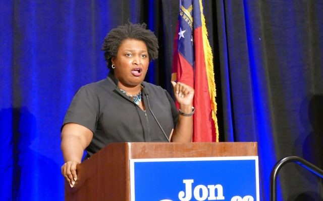 House Minority Leader Stacey Abrams, a likely candidate for governor next year, rallies the Ossoff crowd at the Crown Plaza Ravinia.