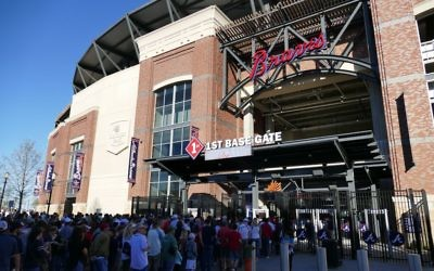 Long security lines await fans at the Atlanta Braves' first game inside their new stadium on March 31.