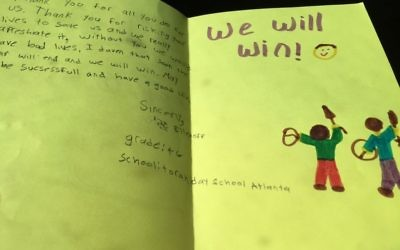 The ZOA mission brought cards such as this one, made by a Torah Day School of Atlanta pupil, to Israeli security personnel.