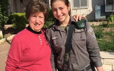 Harriet Cortell brings a border police officer a shaloch manot bag and a card for Purim.