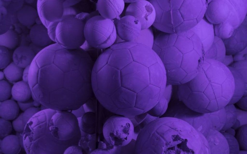 """Photo by Guillaume Ziccarelli, courtesy of Galerie Perrotin Daniel Arsham stands in the middle of his """"Amethyst Sports Ball Cavern,"""" part of the """"Hourglass"""" exhibit at the High Museum of Art."""