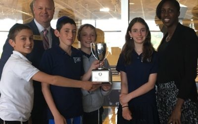 GISA Vice President Stan Whitlock helps Chaya Mushka Children's House math teacher Alison Earle and the team of Levi Kornfeld, Aaron Linder, Dovi Lipskier and Sivan Livnat celebrate finishing second in the GISA state chess tournament April 20.