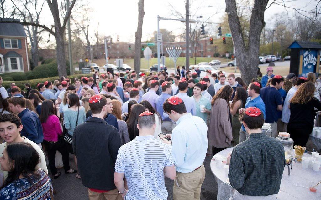 Students mix and mingle at the pre-dinner matzah ball at Chabad at UGA's Shabbat 500 celebration.