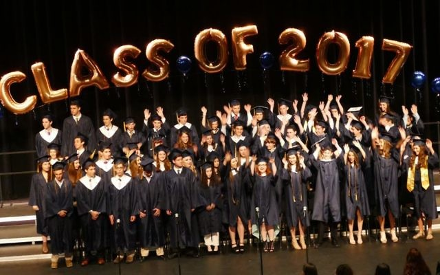 Upon completing their processional, the members of the Weber Class of 2017 do a quick wave before settling in for the hour-long ceremony.