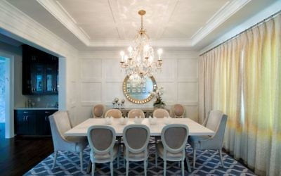 A Dennis & Leen chandelier from Jerry Pair meets the need for lighting that contributes to a calm, clean look throughout. The dining table and chairs are by Bradley USA.