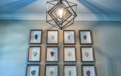 A Kelly Wearstler chandelier highlights a set of geodes by Christopher Marley in the foyer. Beth Brown likes the sustainability of natural and geological materials.