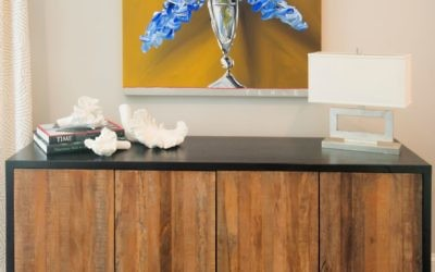 Beth Brown repurposed this colorful Steve Penley oil painting from her parents' house with a credenza by Environment.