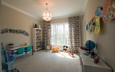 IKEA furnishings in the playroom house toys in reachable and storable bins.