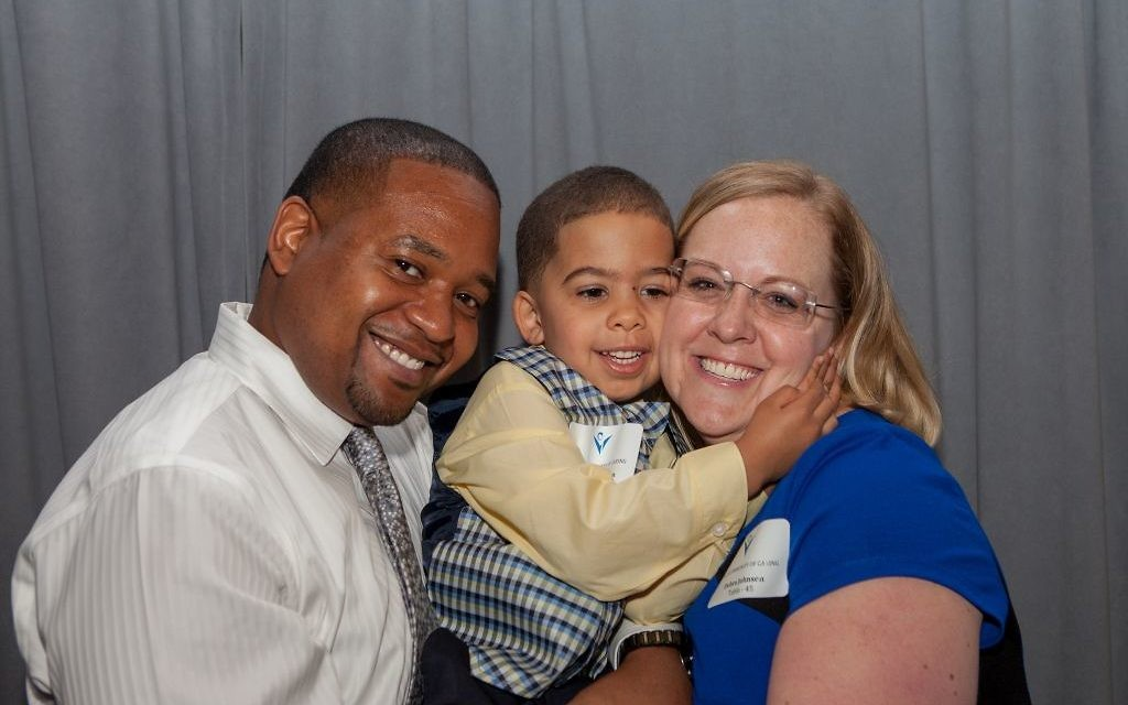 Debra Johnsea is all smiles with husband Mark and son Christian at the JF&CS Community of Caring luncheon after the organization helped her get counseling for post-traumatic stress disorder and substance abuse issues.