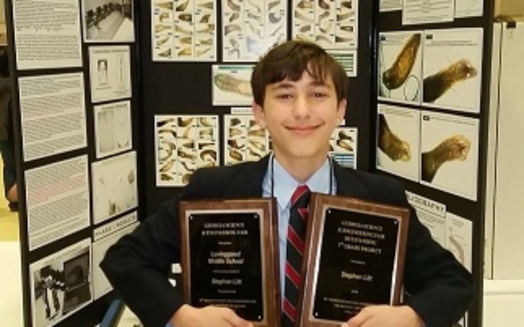 Stephen Litt shows the awards for his science fair project on antioxidants in green tea that inhibit the growth of tumors.