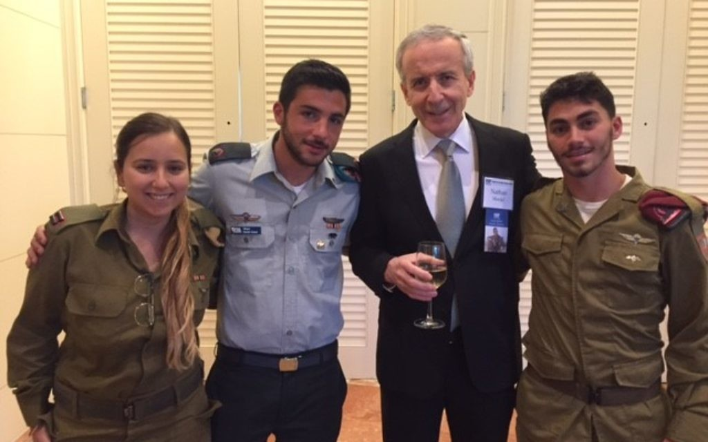 Atlanta physician Nathan Mordel spends time with three Israeli soldiers at the gala: Lt. Ofir Asulin, Maj. Barak Ganot, and Sgt. Eitan, a lone soldier from Miami who is a paratrooper.
