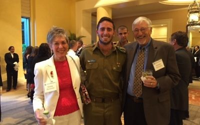 Elaine and Jerry Blumenthal flank FIDF scholarship recipient Mauricio Glucksmann, a native of Venezuela who is studying government in Israel after his military service. As a child in Venezuela, Glucksmann was kidnapped. His parents sent him to Mexico, then to Israel, where he joined the IDF in 2012.