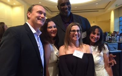 Israeli basketball legend Lavon Mercer, an IDF veteran, stands behind and towers over (from left) recent congressional candidate Ron Slotin, Eti Lazarian, Sloane Barras and Felicia Voloschin at an FIDF event in May 2017.