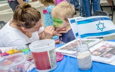 Brian Schwartz goes green at the face-painting table.