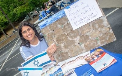 With Tova Shraga's help, people can write notes that will make it to the Kotel.