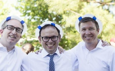 Young Israel Rabbi Adam Starr celebrates with Jay Cinnamon (left) and congregation President Hillel Glazer.