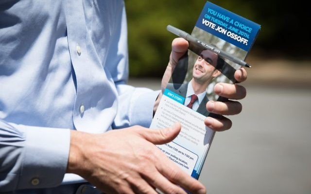 Jon Ossoff goes door to door in Sandy Springs on May 11. (Photo by Dustin Chambers, Ossoff campaign)