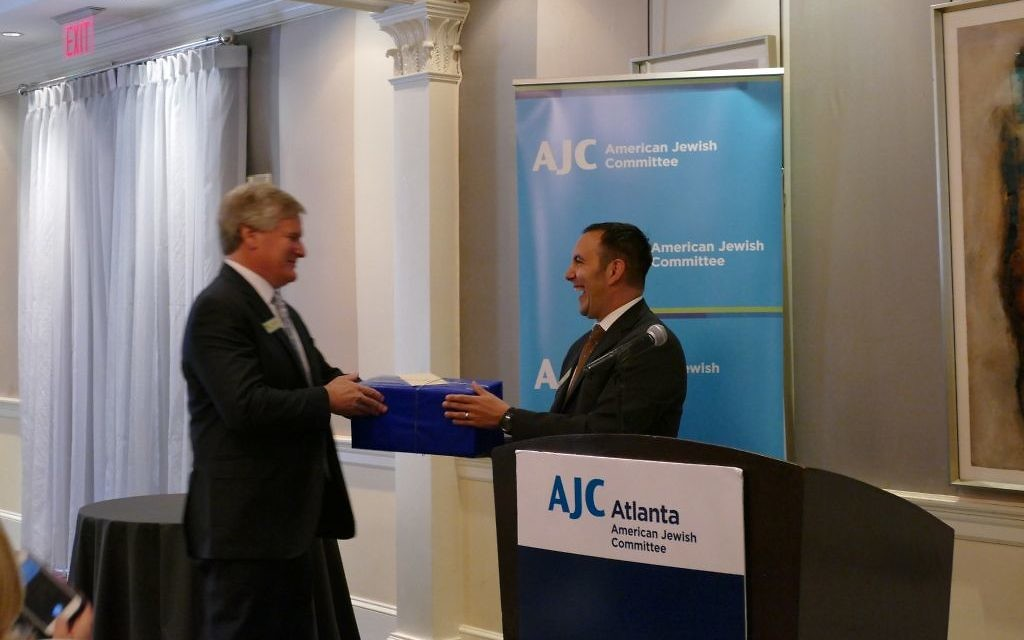 AJC regional director Dov Wilker presents outgoing president Gregg Averbuch with a parting gift on behalf of the AJC.