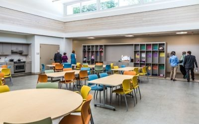 The light-filled hub of the IndependenceWORKS building offers a teaching kitchen and cubbies for clients.