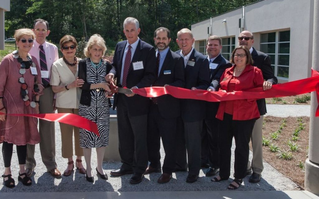 Cutting the ribbon are (from left) Ann Kay, Michael Kay, Lois Blonder, campaign co-chairs Cherie Aviv and John Perlman, JF&CS CEO Rick Aranson, Dunwoody Mayor Denis Shortal, JF&CS President Michael Levy, Dunwoody City Councilwoman Lynn Deutsch, and former JF&CS CEO Gary Miller.
