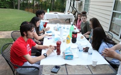 Teens gather in the evening for food, socializing and learning.