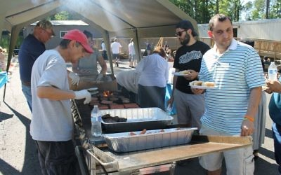 Hamburgers and hot dogs feed the masses at the family celebration.