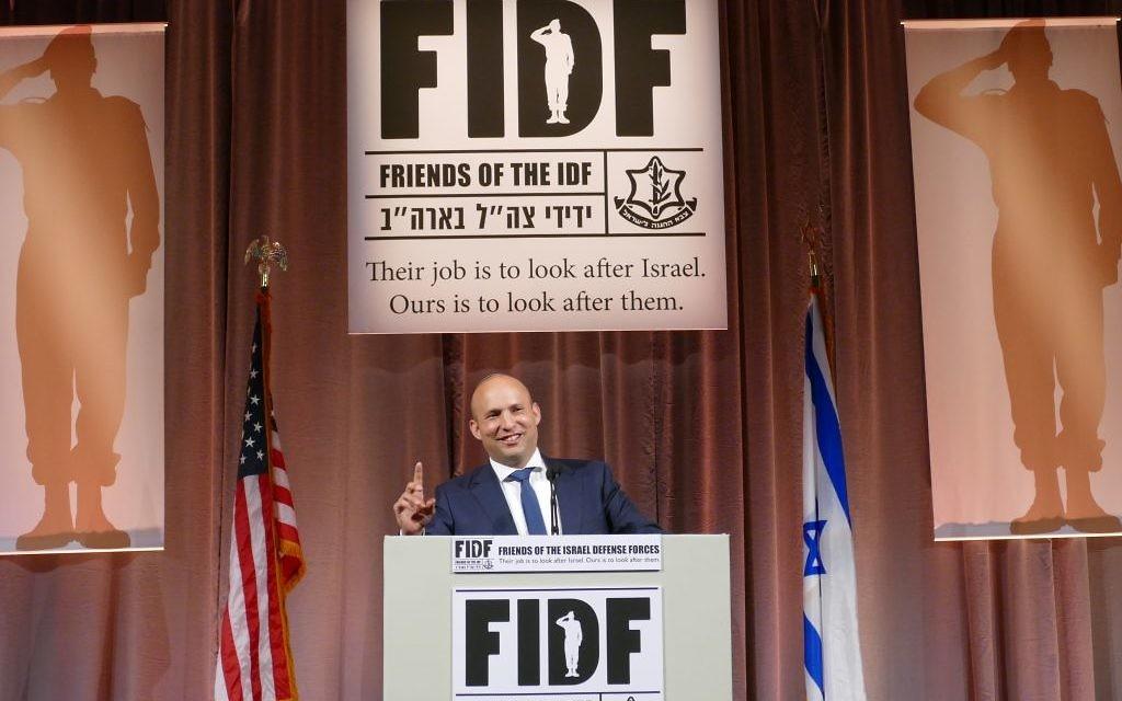 Education and Diaspora Affairs Minister Naftali Bennett speaks at the FIDF gala May 8.